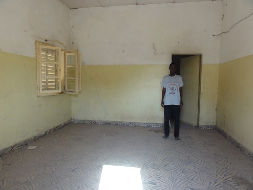 One of the rooms that will house the new beds, and Demba, who is training to be a pharmacist